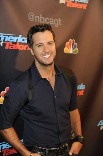 "<div class=""meta ""><span class=""caption-text "">Country singer Luke Bryan poses on the red carpet after the season 8 finale of 'America's Got Talent' at Radio City Music Hall in New York on Sept. 18, 2013. (Lucien Sims / NBC)</span></div>"