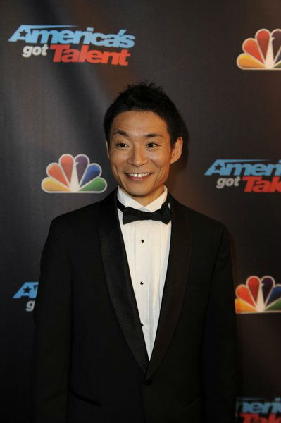 "<div class=""meta image-caption""><div class=""origin-logo origin-image ""><span></span></div><span class=""caption-text"">'America's Got Talent' season 8 winner and dancer Kenichi Ebina poses on the red carpet after the season 8 finale at Radio City Music Hall in New York on Sept. 18, 2013. (Lucien Sims / NBC)</span></div>"