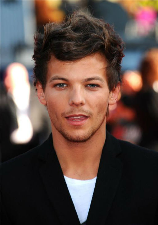 "<div class=""meta ""><span class=""caption-text "">One Direction member Louis Tomlinson walks the red carpet at the premiere of 'One Direction: This Is Us' in London on Aug. 20, 2013. (Anthony Harvey / Startraksphoto.com)</span></div>"