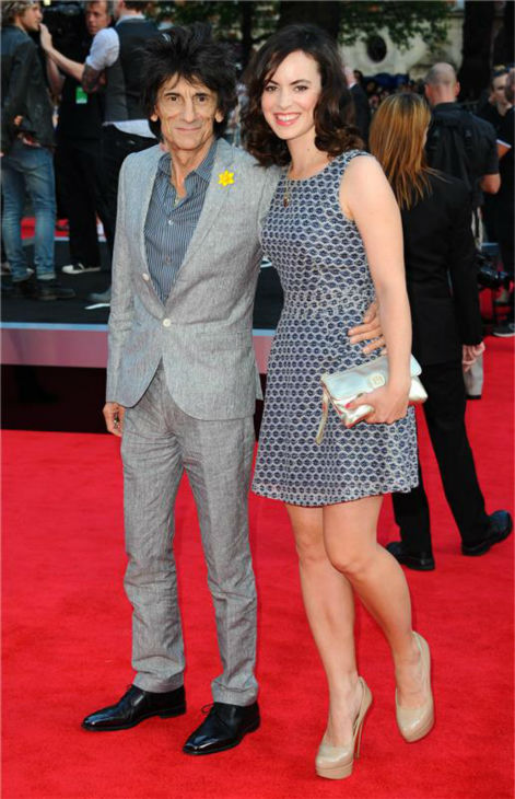 Rolling Stones member Ronnie Wood and wife Sally Humphreys walk the red carpet at the premiere of &#39;One Direction: This Is Us&#39; in London on Aug. 20, 2013. <span class=meta>(Anthony Harvey &#47; Startraksphoto.com)</span>