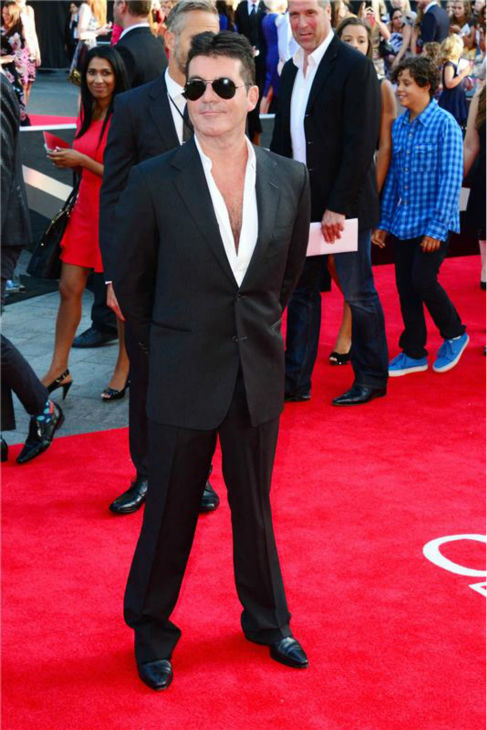 "<div class=""meta ""><span class=""caption-text "">Simon Cowell walks the red carpet at the premiere of 'One Direction: This Is Us' in London on Aug. 20, 2013. The boy band One Direction is signed to the 'X Factor' judge's record company, Syco Music. (Anthony Harvey / Startraksphoto.com)</span></div>"