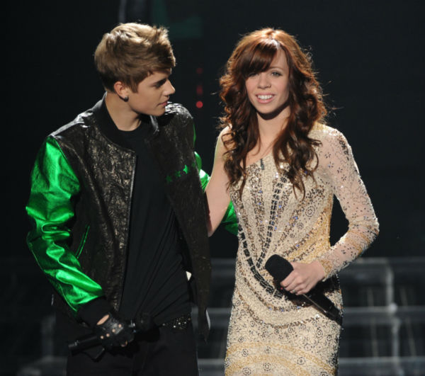 Justin Bieber appears on stage with former 'X Factor' contestant Drew Ryniewicz during the show's season 1 finale on Dec. 22, 2011.