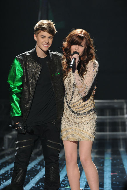 "<div class=""meta image-caption""><div class=""origin-logo origin-image ""><span></span></div><span class=""caption-text"">Justin Bieber appears on stage with former 'X Factor' contestant Drew Ryniewicz during the show's season 1 finale on Dec. 22, 2011. (Ray Mickshaw / FOX)</span></div>"
