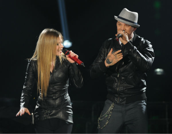 Chris Rene (R) and Avril Lavigne perform her 2002 song 'Complicated' on 'The X Factor' on Dec. 21, 2011 on FOX.