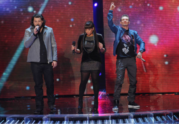 L-R: Top 3 finalists Josh Krajcik, Melanie Amaro and Chris Rene perform on 'The X Factor' finale on Dec. 22, 2011.