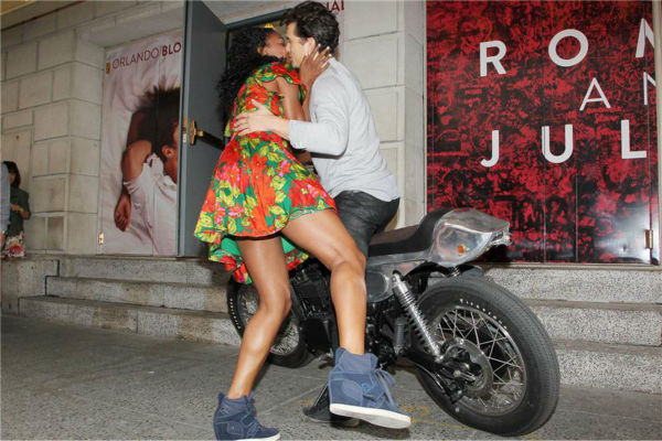 Orlando Bloom and Condola Rashad, stars of the upcoming Broadway production of 'Romeo and Juliet,' kiss on a motorcycle in New York on Aug. 7, 2013. They had just arrived at the show's new home, the Richard Rodgers Theatre, for the first time.