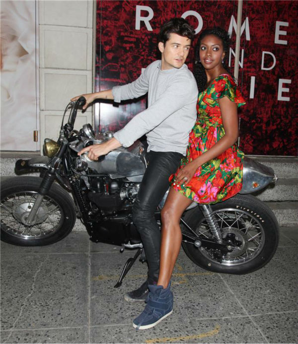 Orlando Bloom and Condola Rashad, stars of the upcoming Broadway production of 'Romeo and Juliet,' ride a motorcycle in New York on Aug. 7, 2013. They had just arrived at the show's new home, the Richard Rodgers Theatre, for the first time.