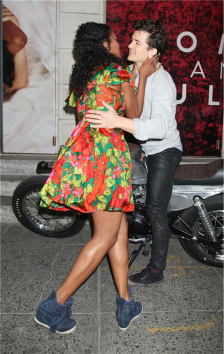 Orlando Bloom and Condola Rashad, stars of the upcoming Broadway production of 'Romeo and Juliet,' prepare to kiss in New York on Aug. 7, 2013. They had just arrived at the show's new home, the Richard Rodgers Theatre, for the first time.