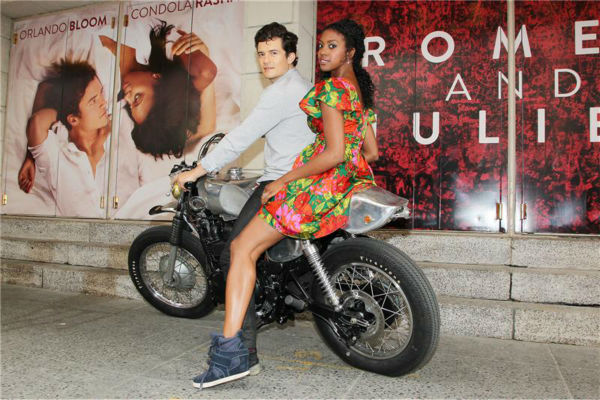 Orlando Bloom and Condola Rashad, stars of the upcoming Broadway production of 'Romeo and Juliet,' ride a motorcycle in New York on Aug. 7, 2013, arriving at the show's new home, the Richard Rodgers Theatre, for the first time.