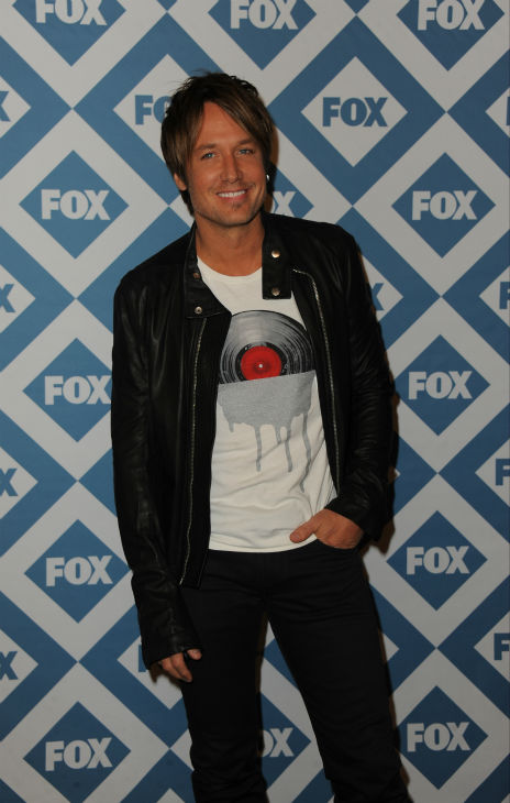 "<div class=""meta ""><span class=""caption-text "">'American Idol' season 13 judge and country star Keith Urban appears at the FOX Winter 2014 event's all-star party at the Langham Hotel in Pasadena, California on Monday, Jan. 13, 2014. (Scott Kirkland / FOX)</span></div>"