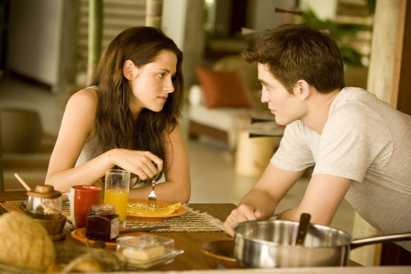 Kristen Stewart and Robert Pattinson appear in a...