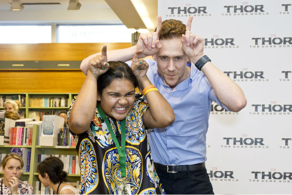 Tom Hiddleston poses with a fan at a 'Thor: The Dark World' fan event in Sydney, Australia on Oct. 9, 2013. He reprises his role as Lok