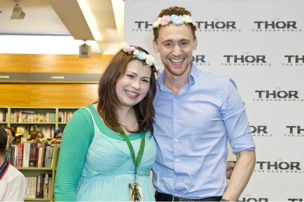 Tom Hiddleston poses with a fan at a 'Thor: The Dark World' fan event in Sydney, Australia on Oct. 9, 2013. He reprises his role as Loki in the Marvel film.
