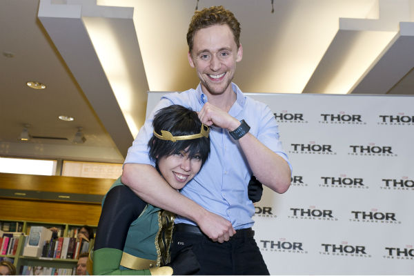 Tom Hiddleston gives a fan a noogie at a &#39;Thor: The Dark World&#39; fan event in Sydney, Australia on Oct. 9, 2013. He reprises his role as Loki in the Marvel film. <span class=meta>(Esteban La Tessa - La Tessa Photography)</span>
