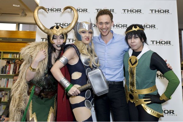 Fans pose with Tom Hiddleston at a 'Thor: The Dark World' fan event in Sydney, Australia on Oct. 9, 2013. He reprises his