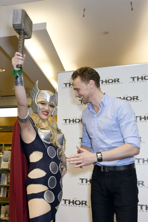 Tom Hiddleston talks to a fan at a 'Thor: The Dark World' fan event in Sydney, Australia on Oct. 9, 2013. He reprises his role as Loki in the Marvel film.