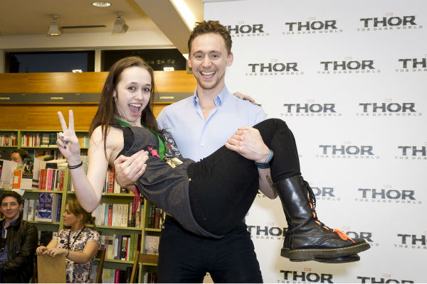 Tom Hiddleston carries a fan at a 'Thor: The Dark World' fan event in Sydney, Australia on Oct. 9, 2013. He reprises his role as Loki in the Marvel film