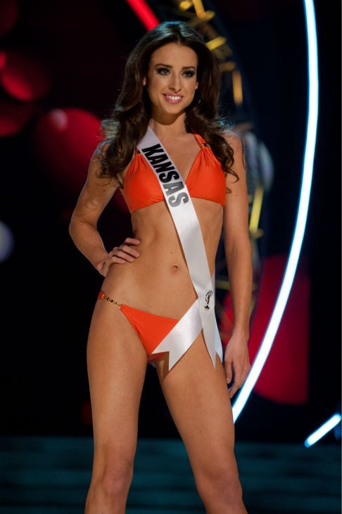 "<div class=""meta ""><span class=""caption-text "">Miss Kansas USA 2013, Staci Klinginsmith, 26, competes in her ViX Paula Hermanny swimsuit and Chinese Laundry shoes during the 2013 MISS USA Competition Preliminary Show at PH Live in Las Vegas, Nevada on Wednesday, June 12, 2013. (Patrick Prather / Miss Universe Organization L.P.)</span></div>"