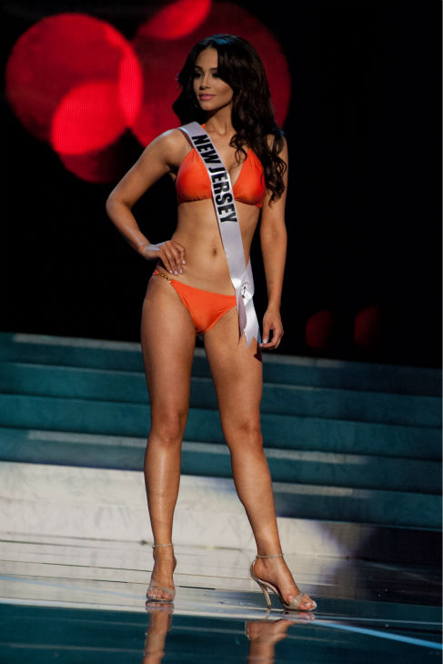 "<div class=""meta image-caption""><div class=""origin-logo origin-image ""><span></span></div><span class=""caption-text"">Miss New Jersey USA 2013, Libell Duran, 22, competes in her ViX Paula Hermanny swimsuit and Chinese Laundry shoes during the 2013 MISS USA Competition Preliminary Show at PH Live in Las Vegas, Nevada on Wednesday, June 12, 2013.   (Patrick Prather / Miss Universe Organization L.P.)</span></div>"