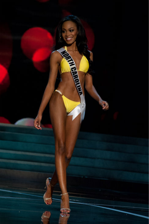 Miss North Carolina USA 2013, Ashley Love-Mills, 24, competes in her ViX Paula Hermanny swimsuit and Chinese Laundry shoes during the 2013 MISS USA Competition Preliminary Show at PH Live in Las Vegas, Nevada on Wednesday, June 12, 2013. <span class=meta>(Patrick Prather &#47; Miss Universe Organization L.P.)</span>