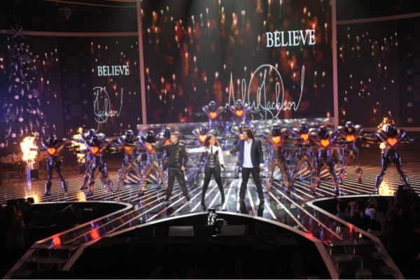 "<div class=""meta ""><span class=""caption-text "">L-R: Chris Rene, Melanie Amaro and Josh Krajcik perform 'They Don't Care About Us' with dancers from 'Cirque du Soleil: Michael Jackson The Immortal World Tour' on 'The X Factor' pre-finale on Dec. 21, 2011. (Ray Mickshaw / FOX)</span></div>"