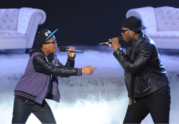 Former 'X Factor' contestant Brian 'Astro' Bradley (L), who famously threw a temper tandrum on an episode, and 50 Cent perform on the FOX show's season 1 finale on Dec. 22, 2011.
