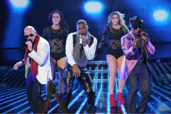 L-R: Pitbull, NeYo  and former 'X Factor' contestant Marcus Canty perform on the season 1 finale on Dec. 22, 2011.