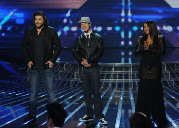 L-R: Top three finalists Josh Krajcik, Melanie Amaro and Chris Rene appears on stage on 'The X Factor' pre-finale on Dec. 21, 2011 on FOX.