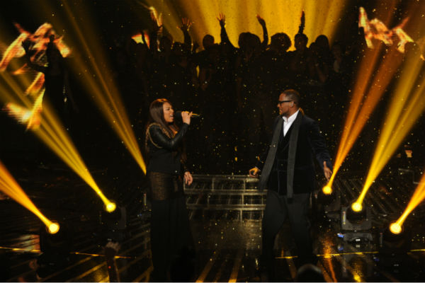Melanie Amaro (L) and R. Kelly perform his 1996 song 'I Believe I Can Fly' on 'The X Factor' pre-finale on Dec. 21, 2011 on FOX.