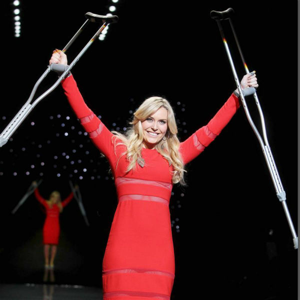 Lindsey Vonn, a champion ski racer, walks the runway in crutches at the Go Red For Women&#47;The Heart Truth Red Dress 2014 Collection fashion show during Mercedes-Benz Fashion Week in New York on Feb. 6, 2014. She had suffered injuries in 2013 and underwent knee surgery in November, which forced her to miss competing in the 2014 Winter Olympics in Sochi, Russia. She is wearing a design by Cynthia Rowley. <span class=meta>(Amanda Schwab &#47; Startraksphoto.com)</span>