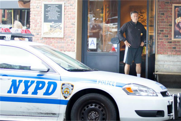 "<div class=""meta ""><span class=""caption-text "">Alec Baldwin appears next to a police squad car after he and a member of the paparazzi got into an altercation in New York City, outside of Grey Dog restaurant, in front of the actor's wife, Hilaria, on Aug. 27, 2013. Police arrived at the scene and spoke to both men. No arrests were made and no charges were filed. (Freddie Baez / startraksphoto.com)</span></div>"