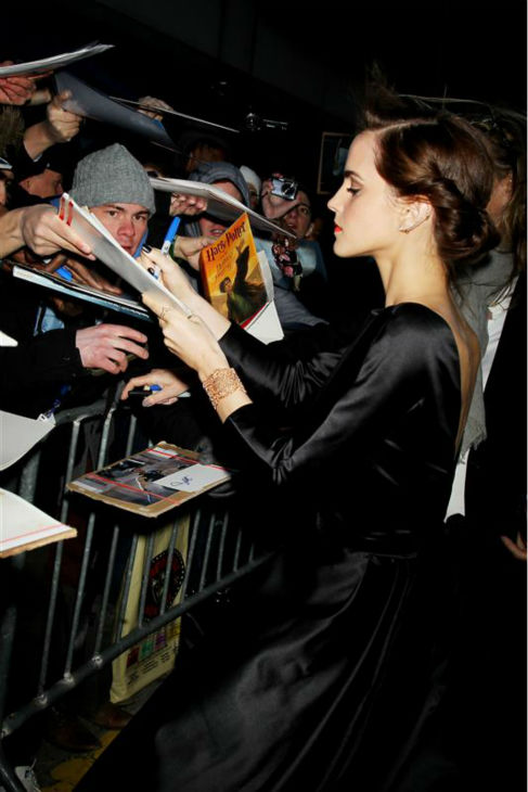 Emma Watson signs autographs for fans at the premiere of &#39;Noah&#39; in New York on March 26, 2014. The actress, who is wearing a black, satin Oscar de la Renta Fall 2014 gown, plays Ila, the wife of Noah&#39;s eldest son, Shem, in Darren Aronofsky&#39;s movie. <span class=meta>(Dave Allocca &#47; Startraksphoto.com)</span>