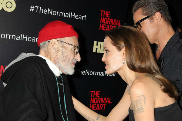 &#39;The Normal Heart&#39; playwright Larry Kramer appears with Angelina Jolie and Brad Pitt at the premiere of the HBO film in New York on May 12, 2014. <span class=meta>(Dave Allocca &#47; Startraksphoto.com)</span>