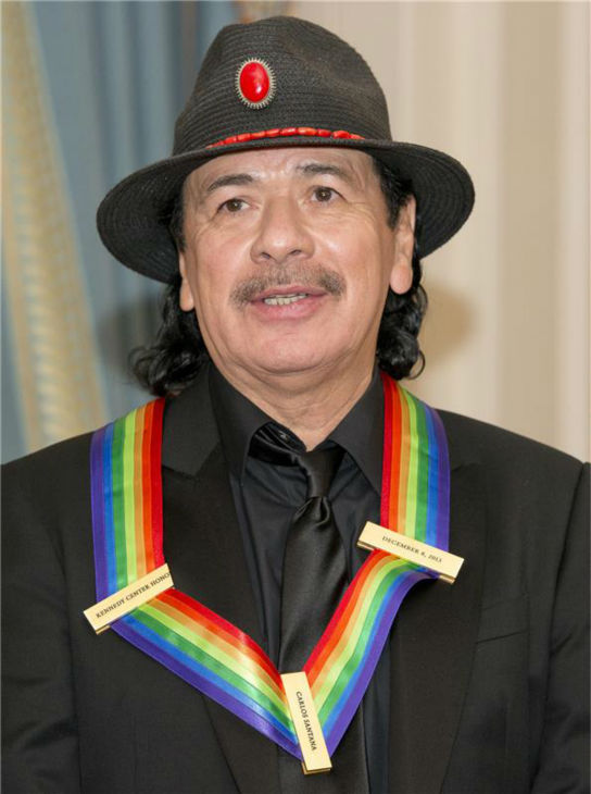 "<div class=""meta ""><span class=""caption-text "">Carlos Santana attends a ceremony for the 2013 Kennedy Center honorees in Washington D.C. on Dec. 8, 2013. The guitarist was one of the five. (Ron Sachs / Startraksphoto.com)</span></div>"