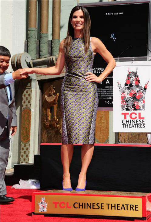 Sandra Bullock leaves her footprints in cement at the TCL Chinese Theatre in Hollywood on Sept. 25, 2013. <span class=meta>(Sara De Boer &#47; Startraksphoto.com)</span>