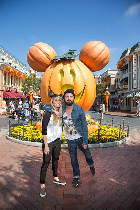 'Breaking Bad' star Aaron Paul and his wife Lauren Parsekian celebrate 'Halloween Time' at Disneyland in Anaheim, California on Tuesday, Sept. 17, 2013.