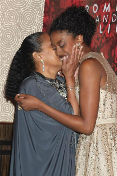 'Cosby Show' alum Phylicia Rashad kisses daughter Condola Rashad at the opening night party for the play 'Romeo and Juliet' on Sept. 19, 2013.