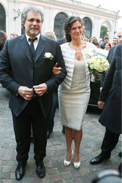 "<div class=""meta ""><span class=""caption-text "">Andrea Bocelli's bride, longtime partner Veronica Berti appears at their wedding with an unidentified man at the Sanctuary of Montenero in Italy on March 21, 2014. This marks the second marriage for the famed Italian tenor. He and Berti are parents to a daughter, who celebrated her second birthday on their wedding day, and he also has two sons from a previous marriage. (Masjordan Image / Abaca / Startraksphoto.com)</span></div>"