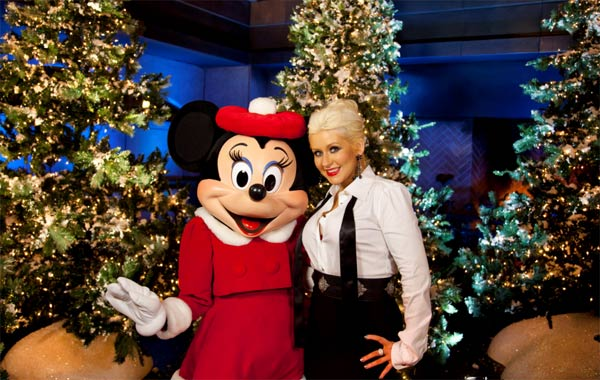Christina Aguilera poses with Minnie Mouse following the taping of the 2011 Disney Parks Christmas Day Parade at Disney's Grand Californian Hotel and Spa in Anaheim, California, on Nov. 6, 2011.