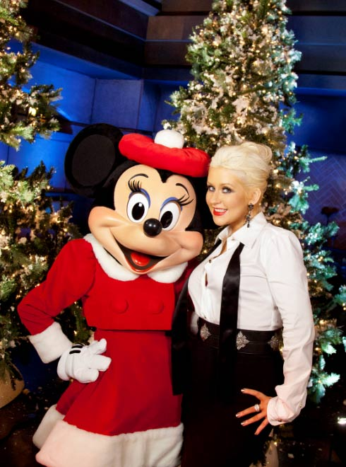 "<div class=""meta image-caption""><div class=""origin-logo origin-image ""><span></span></div><span class=""caption-text"">Christina Aguilera poses with Minnie Mouse following the taping of the 2011 Disney Parks Christmas Day Parade at Disney's Grand Californian Hotel and Spa in Anaheim, California, on Nov. 6, 2011. The show airs Christmas Day, at various times across the country, on ABC.  (Paul Hiffmeyer / Disneyland)</span></div>"
