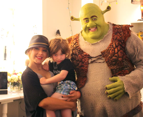 Christina Aguilera appears with her son Max and Eric Peterson at the actor's dressing room at the Pantages Theatre in Los Angeles during an intermission of the musical, 'Shrek' on July 19, 2011.
