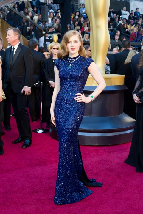 Amy Adams arrives for the 83rd Annual Academy Awards at the Kodak Theatre in Hollywood, Calif. on Feb. 27, 2011. The actress sparkled in a floor-length, sequined L&#39;Wren Scott gown that she paired with eye-catching turquoise jewelry. The 2013 Oscar ceremony is scheduled to air February 24 on ABC. <span class=meta>(A.M.P.A.S.)</span>