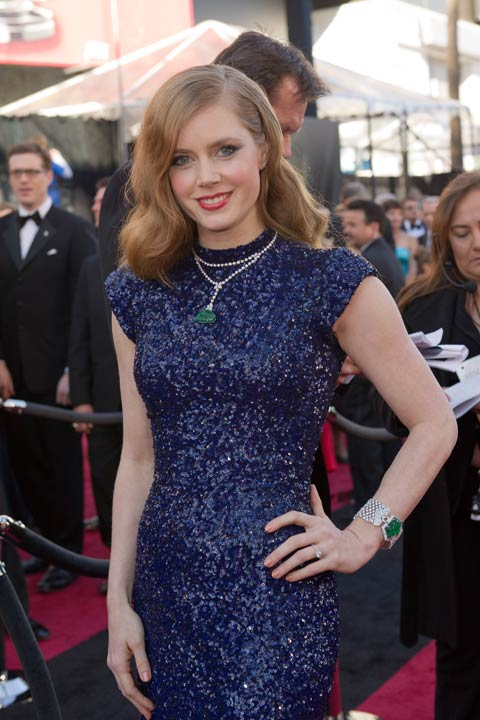 "<div class=""meta ""><span class=""caption-text "">Amy Adams arrives for the 83rd Annual Academy Awards at the Kodak Theatre in Hollywood, Calif. on Feb. 27, 2011. The actress sparkled in a floor-length, sequined L'Wren Scott gown that she paired with eye-catching turquoise jewelry. The 2013 Oscar ceremony is scheduled to air February 24 on ABC. (A.M.P.A.S.)</span></div>"