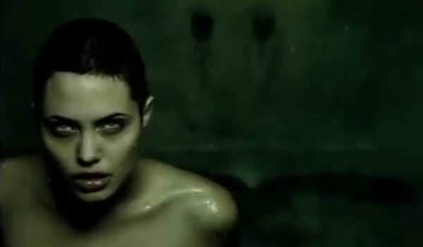 Angelina Jolie appears in a scene from the 1997 music video 'Anybody Seen My Baby.'