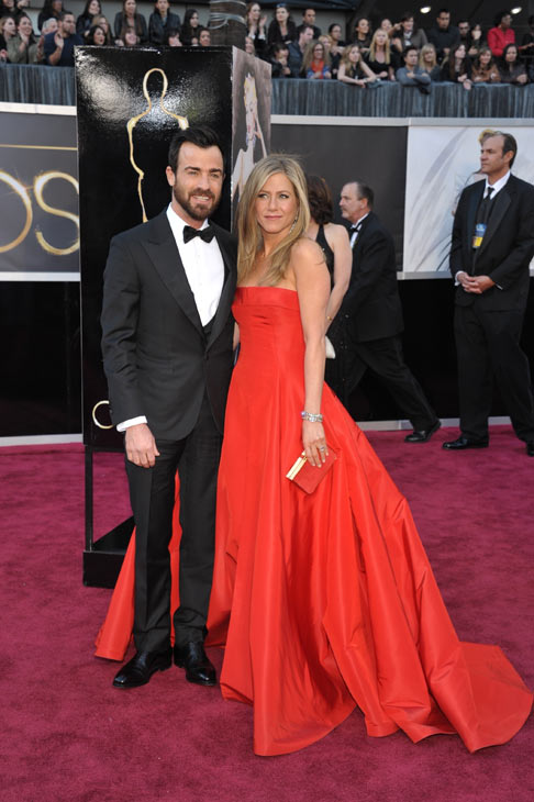 Actors Justin Theroux, left, and Jennifer...