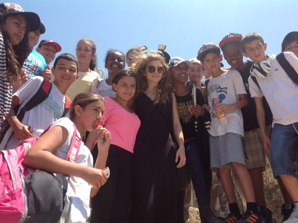 AnnaLynne McCord of the CW show '90210' appears with children in Caesarea during a celebrity trip to Israel on May 7, 2012.