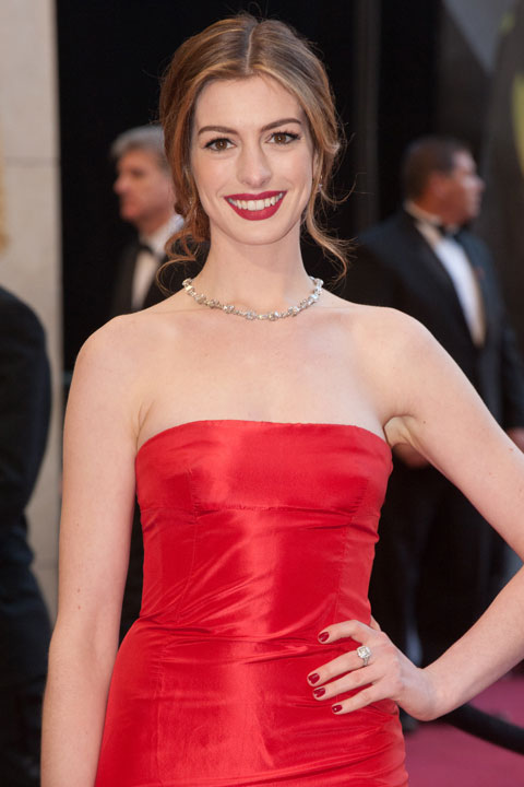 Anne Hathaway arrives for the 83rd Annual Academy Awards at the Kodak Theatre in Hollywood, Calif. on Feb. 27, 2011. The actress sizzled in a red, floor-length Vintage Versace gown which she paired with a sleek up-do and a bright red pout.  The 2013 Oscar ceremony is scheduled to air February 24 on ABC. <span class=meta>(Jonathan Selig &#47; A.M.P.A.S.)</span>