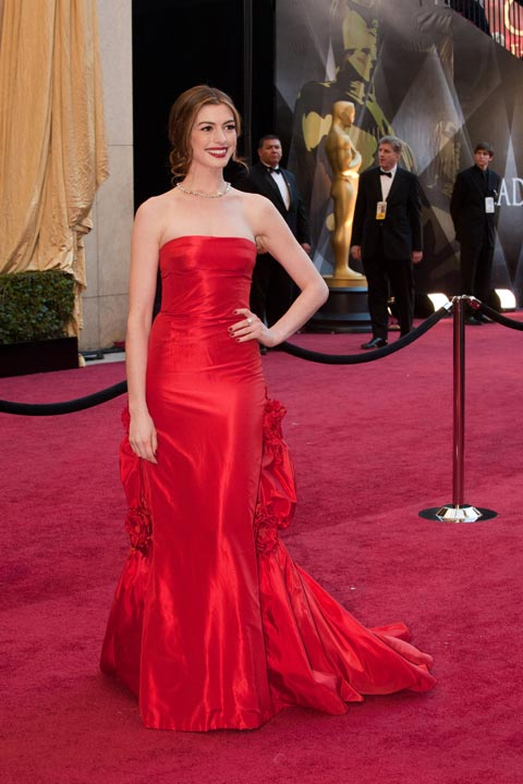 "<div class=""meta image-caption""><div class=""origin-logo origin-image ""><span></span></div><span class=""caption-text"">Anne Hathaway arrives for the 83rd Annual Academy Awards at the Kodak Theatre in Hollywood, Calif. on Feb. 27, 2011. The actress sizzled in a red, floor-length Vintage Versace gown which she paired with a sleek up-do and a bright red pout.  The 2013 Oscar ceremony is scheduled to air February 24 on ABC. (Jonathan Selig / A.M.P.A.S.)</span></div>"
