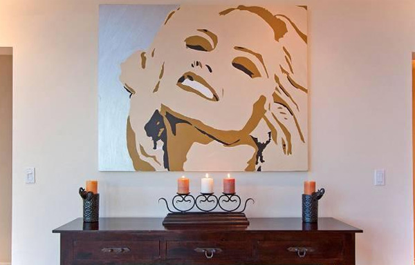A painting of Anna Nicole Smith appears inside the Hollywood Hills home of the late actress. The 5-bedroom house was listed for sale for $1.75 million in late July 2011.
