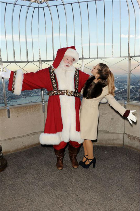 Ariana Grande poses with Santa Claus at the Empire State Building on Nov. 25, 2013. She lit the New York City landmark in festive fall colors in honor of Macy&#39;s Thanksgiving Day Parade. <span class=meta>(Amanda Schwab &#47; Startraksphoto.com)</span>